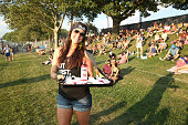 A brand ambassador from Bai serves drinks on day one of The Panorama Music Festival at Randall's Island on July 22 2016 in New York City