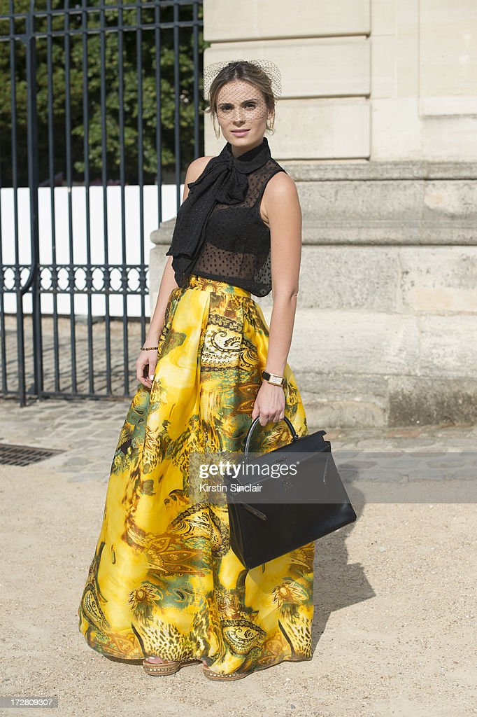 Brand Consultant Wilma Helena Faisson wears Christian Louboutin shoes, a Hermes bag, Mixed top, Custom made skirt and Dior headpiece on day 1 of Paris Collections: Womens Haute Couture on July 01, 2013 in Paris, France.