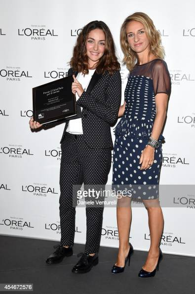 Brand director of L'Oreal Paris Italia Stefania Fabiano poses with winner Valentina Corti at the 'L'Oreal Paris award for the Cinema' photocall...