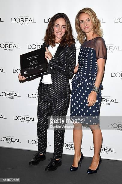 Brand director of L'Oreal Paris Italia Stefania Fabiano poses with winner Valentina Corti at the 'L'Oreal Paris award for the Cinema' photocall...