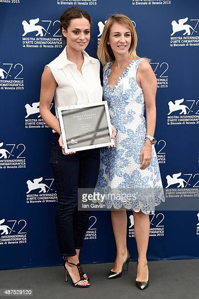 Brand director of L'Oreal Paris Italia Stefania Fabiano poses with winner Valeria Bilello at a photocall for L'Oreal Paris Award For Cinema during...