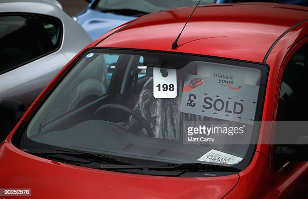 A brand new car awaits collection at a car dealer on September 1 2009 in Bodmin England New cars registered from today will display the new '59'...