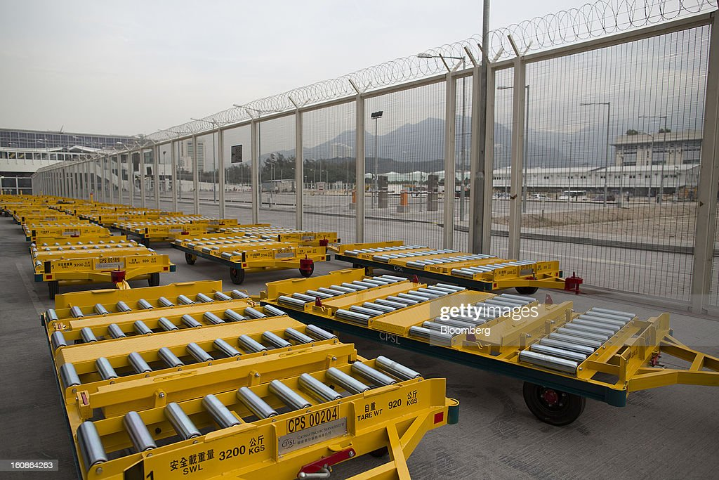 Brand new cargo trolleys sit in the Cathay Pacific Cargo Terminal in Hong Kong, China, on Monday, Feb. 4, 2013. Cathay Pacific Airways Ltd. aims to replicate its business-class strategy in a cargo trade upgrade. Photographer: Jerome Favre/Bloomberg via Getty Images