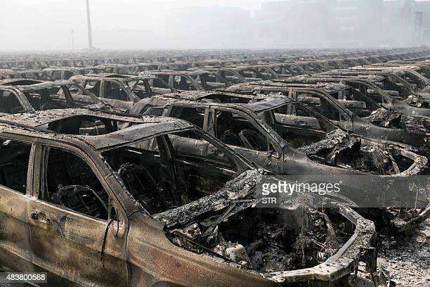 Brand new cars parked in Tianjin port are seen badly damaged at the site of the massive explosions in Tianjin on August 13 2015 Enormous explosions...