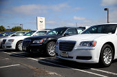 Brand new Chrysler cars are displayed on the sales lot at Chrysler Jeep Dodge Ram Marin on September 3 2014 in Corte Madera California Chrysler Group...