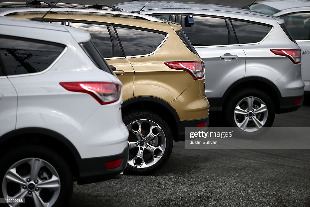Brand new Ford Escape compact crossover vehicles are displayed at Serramonte Ford on July 16, 2014 in Colma, California. According to a report by IHS Automotive, new registrations on SUVs and crossover vehicles surpassed sedans for the first time with SUVs and crossovers taking 36.5 percent of registrations while sedans registered 35.4 percent.