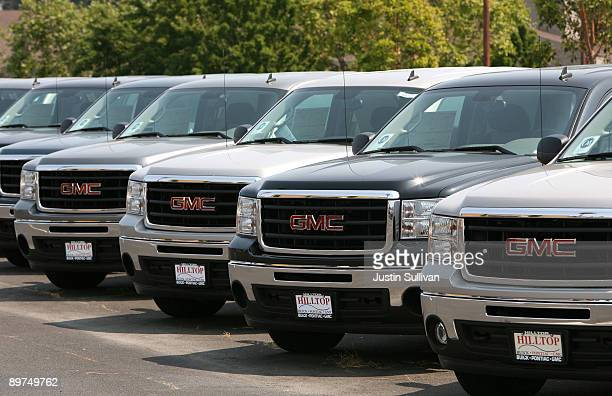 Brand new GMC trucks are displayed at Hilltop Buick PontiacGMC August 11 2009 in Richmond California Hundreds of General Motors California dealers...