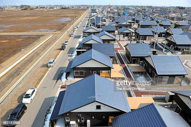 Brand new houses are seen while land facing sea remain vacant on February 11 2015 in Iwanuma Miyagi Japan This is the first large scale collective...