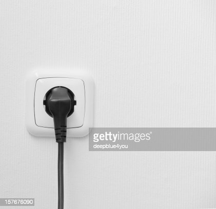 brand new outlet on a white wall with plug