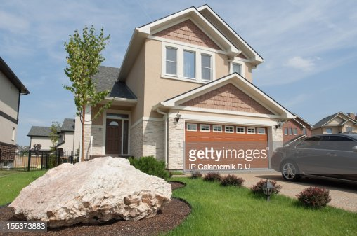Brand new suburban house in sunny summer afternoon.