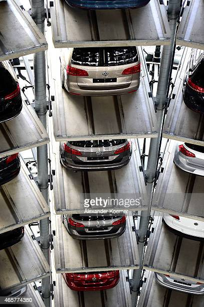 Brand new Volkswagen cars are stored in a tower at the Volkswagen Autostadt complex near the Volkswagen factory on March 10 2015 in Wolfsburg Germany...
