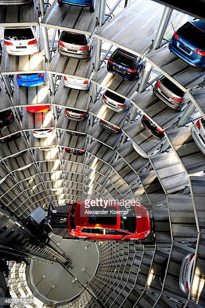 A brand new Volkswagen Golf 7 car is stored in a tower at the Volkswagen Autostadt complex near the Volkswagen factory on March 10 2015 in Wolfsburg...