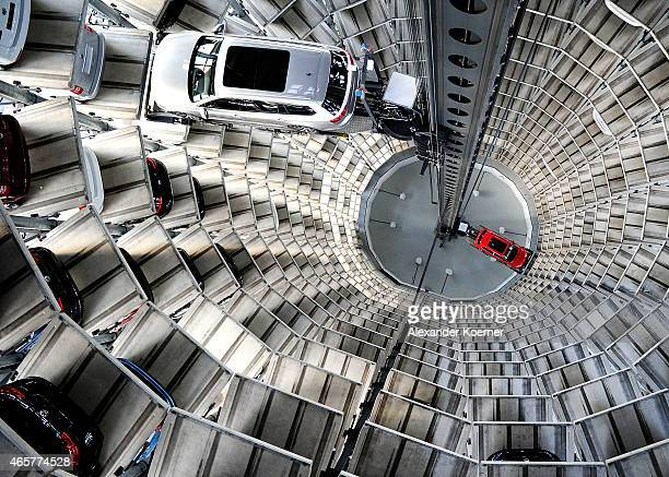 A brand new Volkswagen Passat and a Golf 7 car are stored in a tower at the Volkswagen Autostadt complex near the Volkswagen factory on March 10 2015...