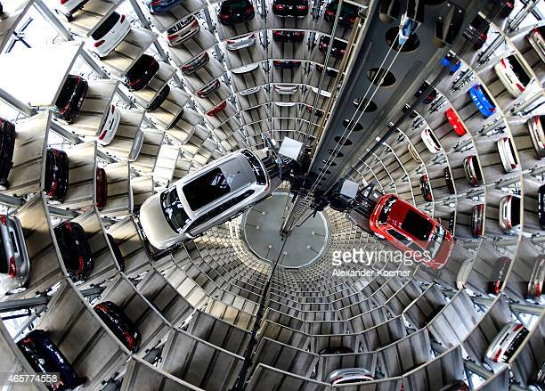 A brand new Volkswagen Passat and Golf 7 car stands stored in a tower at the Volkswagen Autostadt complex near the Volkswagen factory on March 10...