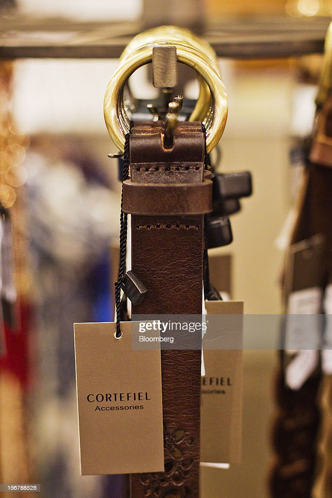 Brand tags hang from leather belts on display inside a Cortefiel SA store in Majadahonda, near Madrid, Spain, on Tuesday, Nov. 20, 2012. Bank of Spain Governor Luis Maria Linde said the government risks missing its budget targets this year and next, adding to doubts on Prime Minister Mariano Rajoy's ability to cut the deficit amid a five-year slump. Photographer: Angel Navarrete/Bloomberg via Getty Images