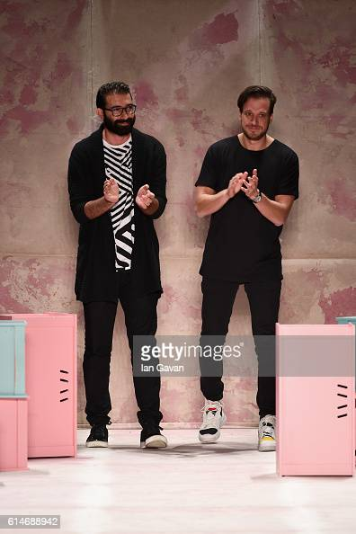 Brand Who designers walk at the Brand Who show during MercedesBenz Fashion Week Istanbul at Zorlu Center on October 14 2016 in Istanbul Turkey
