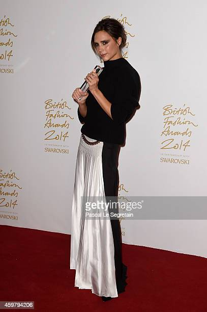 Brand winner Victoria Beckham poses in the winners room at the British Fashion Awards at London Coliseum on December 1 2014 in London England