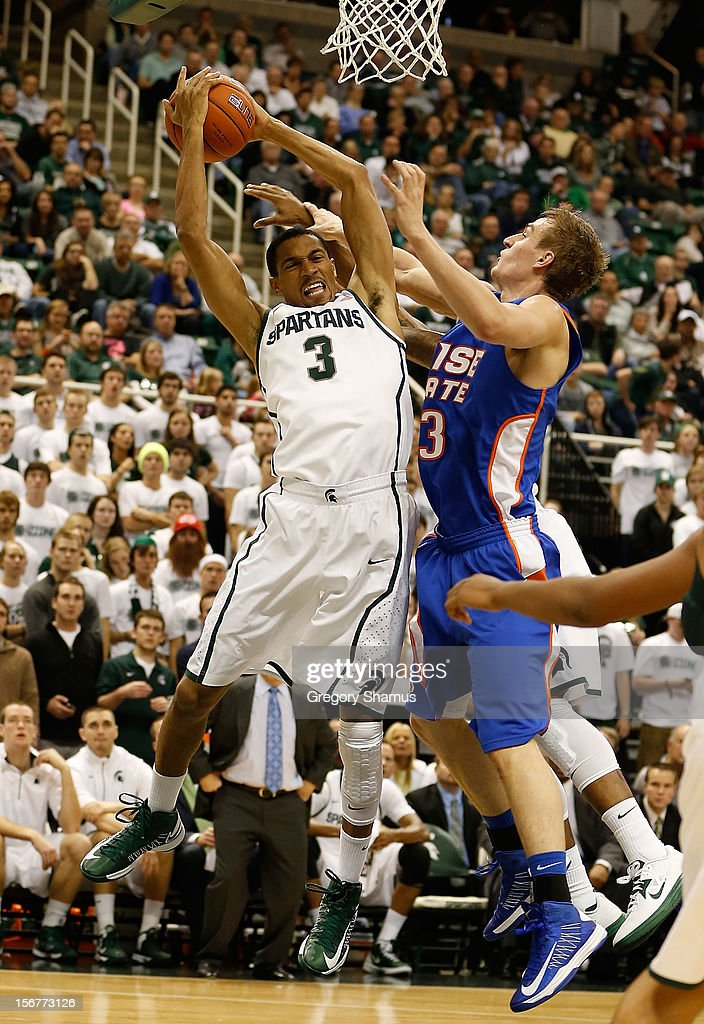Brandan Kearney #3 of the Michigan State Spartans grabs a rebound next to Anthony Drmic #3 of the Boise State Broncos at the Breslin Center on November 20, 2012 in East Lansing, Michigan.