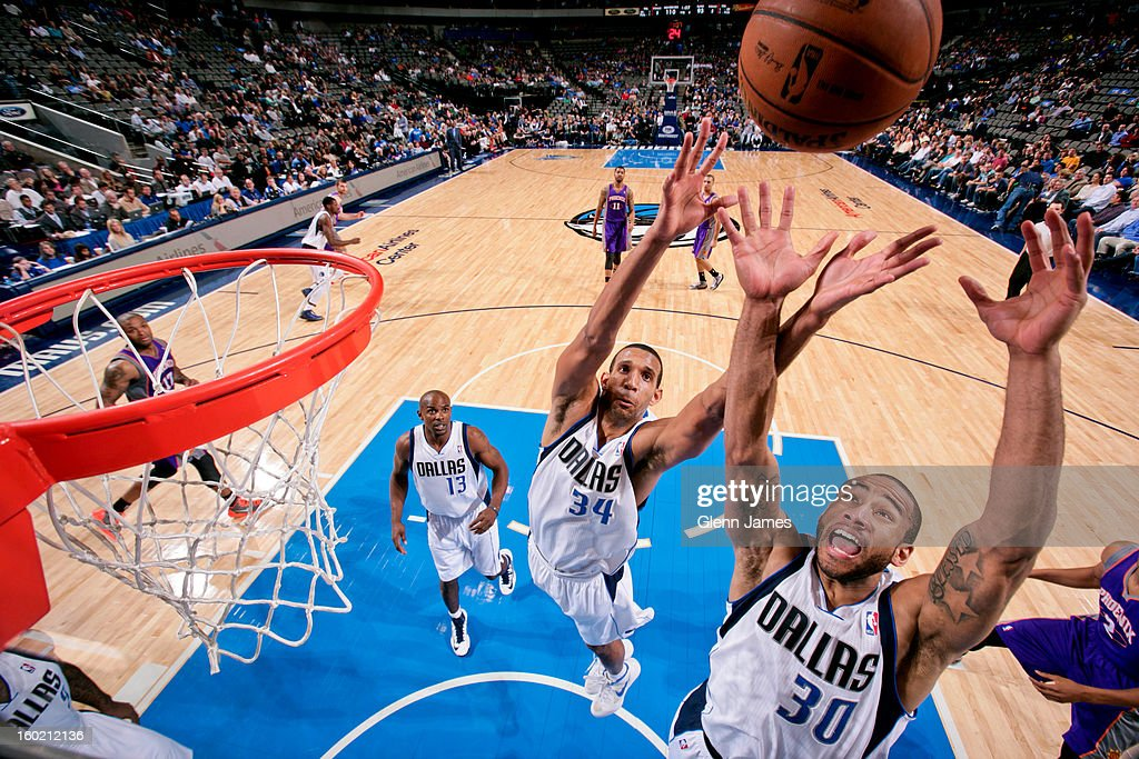 <a gi-track='captionPersonalityLinkClicked' href=/galleries/search?phrase=Brandan+Wright&family=editorial&specificpeople=3847557 ng-click='$event.stopPropagation()'>Brandan Wright</a> #34 and <a gi-track='captionPersonalityLinkClicked' href=/galleries/search?phrase=Dahntay+Jones&family=editorial&specificpeople=202206 ng-click='$event.stopPropagation()'>Dahntay Jones</a> #30 of the Dallas Mavericks go up for a rebound against the Phoenix Suns on January 27, 2013 at the American Airlines Center in Dallas, Texas.