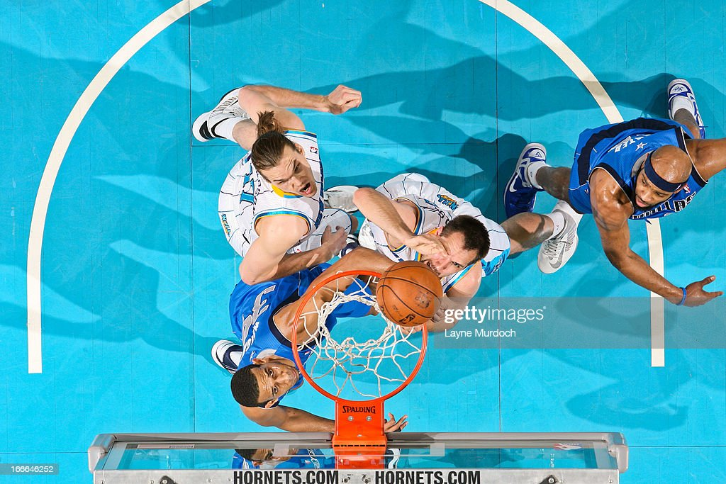 Brandan Wright #34 of the Dallas Mavericks and Lou Amundson #17 and Ryan Anderson #33 of the New Orleans Hornets watch as the ball rolls on the cylinder during their game on April 14, 2013 at the New Orleans Arena in New Orleans, Louisiana.