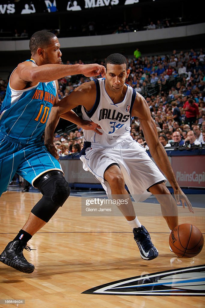 Brandan Wright #34 of the Dallas Mavericks dribbles against Eric Gordon #10 of the New Orleans Hornets on April 17, 2013 at the American Airlines Center in Dallas, Texas.