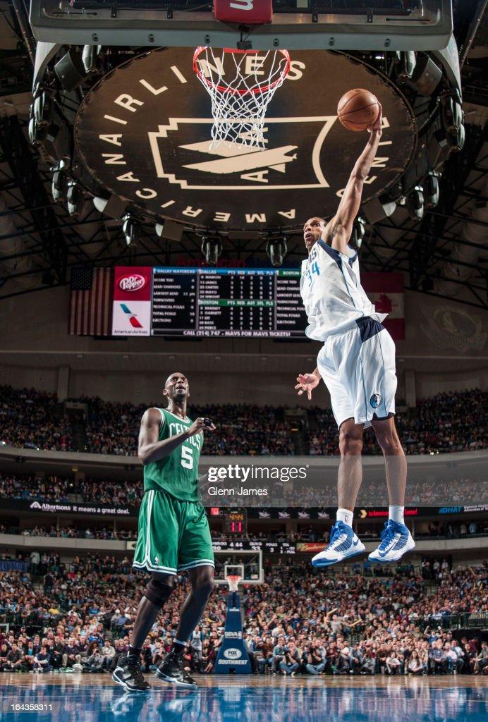 Brandan Wright #34 of the Dallas Mavericks dunks against Kevin Garnett #5 of the Boston Celtics on March 22, 2013 at the American Airlines Center in Dallas, Texas.