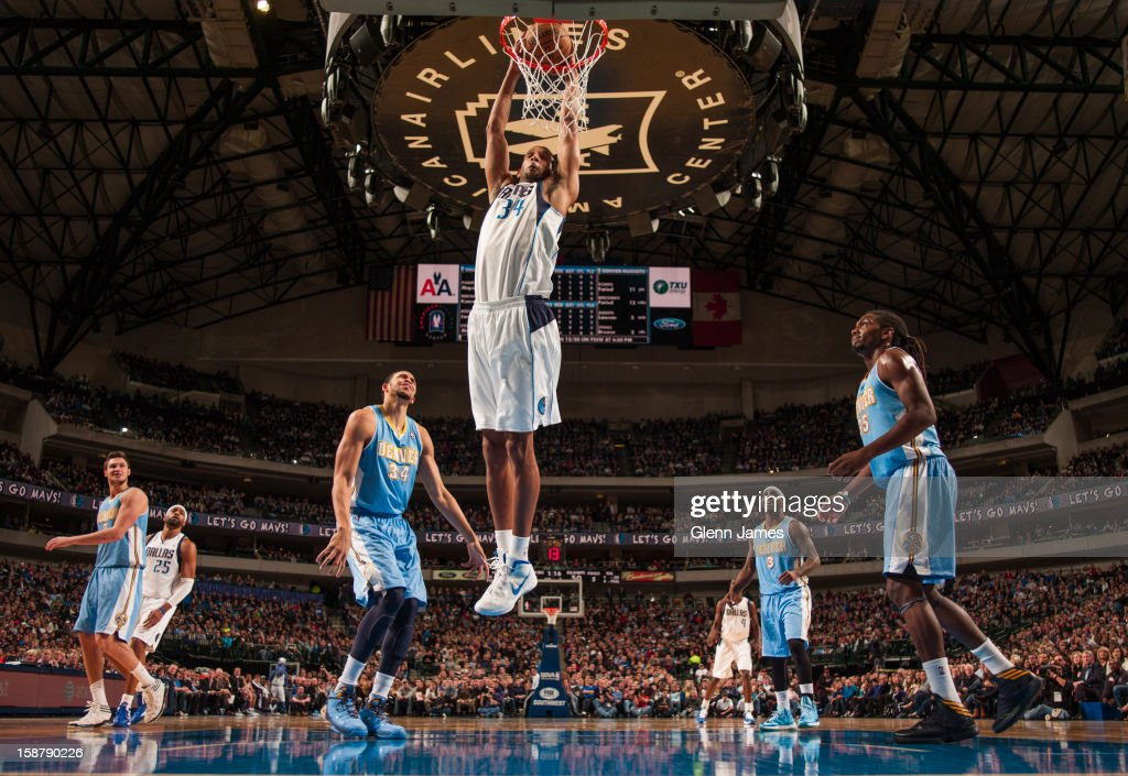 Brandan Wright #34 of the Dallas Mavericks dunks against the Denver Nuggets on December 28, 2012 at the American Airlines Center in Dallas, Texas.
