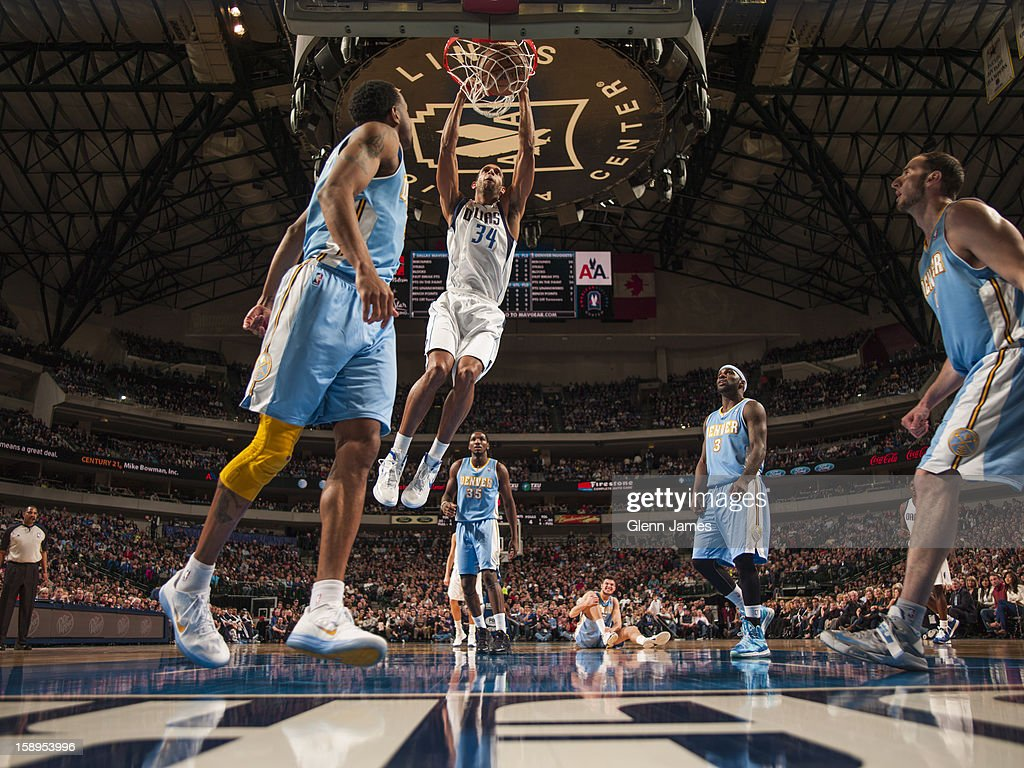<a gi-track='captionPersonalityLinkClicked' href=/galleries/search?phrase=Brandan+Wright&family=editorial&specificpeople=3847557 ng-click='$event.stopPropagation()'>Brandan Wright</a> #34 of the Dallas Mavericks dunks the ball against the Denver Nuggets on December 28, 2012 at the American Airlines Center in Dallas, Texas.