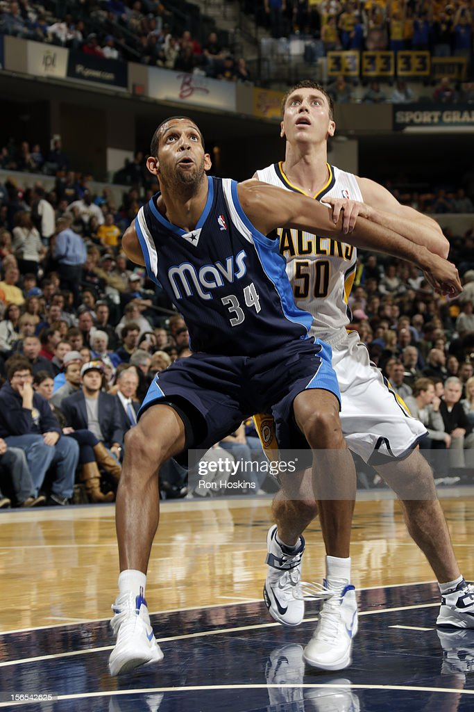 Brandan Wright #34 of the Dallas Mavericks fights for position against Tyler Hansbrough #50 of the Indiana Pacers on November 16, 2012 at Bankers Life Fieldhouse in Indianapolis, Indiana.