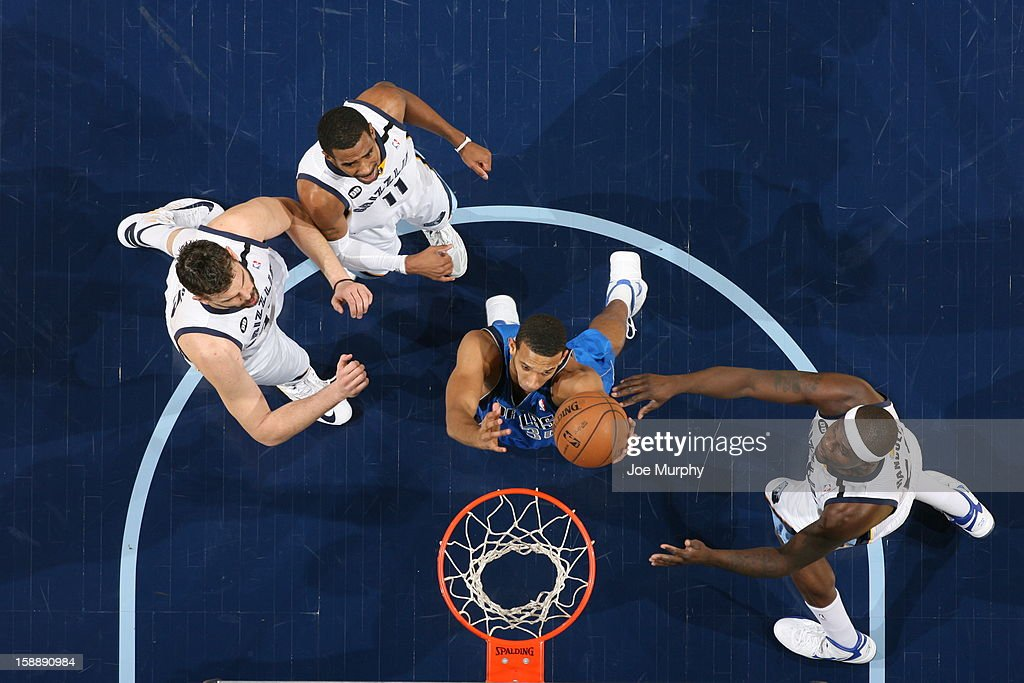 <a gi-track='captionPersonalityLinkClicked' href=/galleries/search?phrase=Brandan+Wright&family=editorial&specificpeople=3847557 ng-click='$event.stopPropagation()'>Brandan Wright</a> #34 of the Dallas Mavericks goes to the basket against <a gi-track='captionPersonalityLinkClicked' href=/galleries/search?phrase=Marc+Gasol&family=editorial&specificpeople=661205 ng-click='$event.stopPropagation()'>Marc Gasol</a> #33, Mike Conley #11 and <a gi-track='captionPersonalityLinkClicked' href=/galleries/search?phrase=Zach+Randolph&family=editorial&specificpeople=201595 ng-click='$event.stopPropagation()'>Zach Randolph</a> #50 of the Memphis Grizzlies on December 21, 2012 at FedExForum in Memphis, Tennessee.