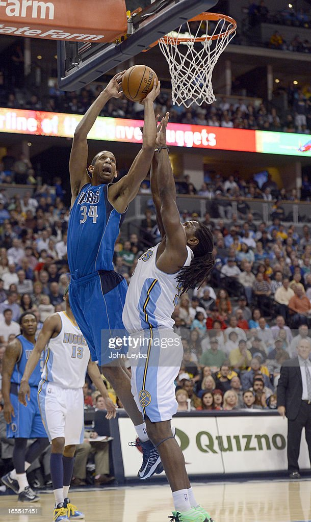 Brandan Wright (34) of the Dallas Mavericks goes up for a shot over Kenneth Faried (35) of the Denver Nuggets during the fourth quarter April 4, 2013 at Pepsi Center.
