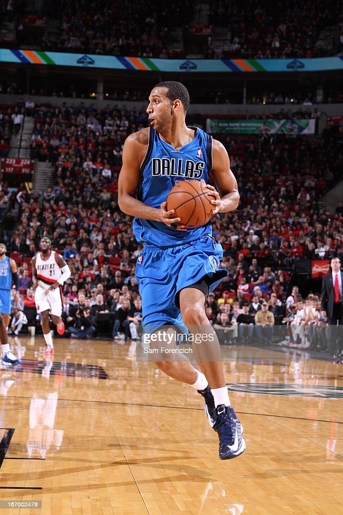 <a gi-track='captionPersonalityLinkClicked' href=/galleries/search?phrase=Brandan+Wright&family=editorial&specificpeople=3847557 ng-click='$event.stopPropagation()'>Brandan Wright</a> #34 of the Dallas Mavericks grabs a rebound against the Portland Trail Blazers on April 7, 2013 at the Rose Garden Arena in Portland, Oregon.