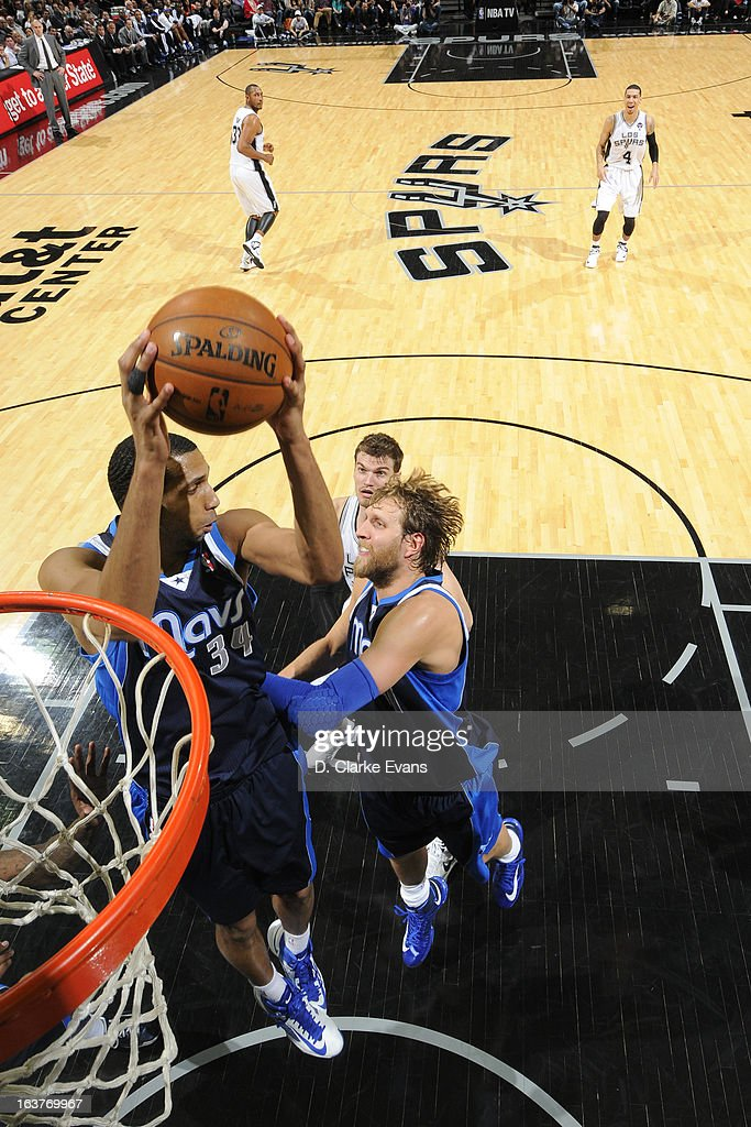 <a gi-track='captionPersonalityLinkClicked' href=/galleries/search?phrase=Brandan+Wright&family=editorial&specificpeople=3847557 ng-click='$event.stopPropagation()'>Brandan Wright</a> #34 of the Dallas Mavericks grabs the rebound against the San Antonio Spurs on March 14, 2013 at the AT&T Center in San Antonio, Texas.