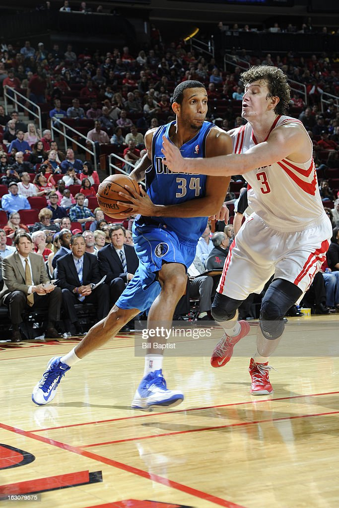 <a gi-track='captionPersonalityLinkClicked' href=/galleries/search?phrase=Brandan+Wright&family=editorial&specificpeople=3847557 ng-click='$event.stopPropagation()'>Brandan Wright</a> #34 of the Dallas Mavericks handles the ball against <a gi-track='captionPersonalityLinkClicked' href=/galleries/search?phrase=Omer+Asik&family=editorial&specificpeople=4946055 ng-click='$event.stopPropagation()'>Omer Asik</a> #3 of the Houston Rockets on March 3, 2013 at the Toyota Center in Houston, Texas.