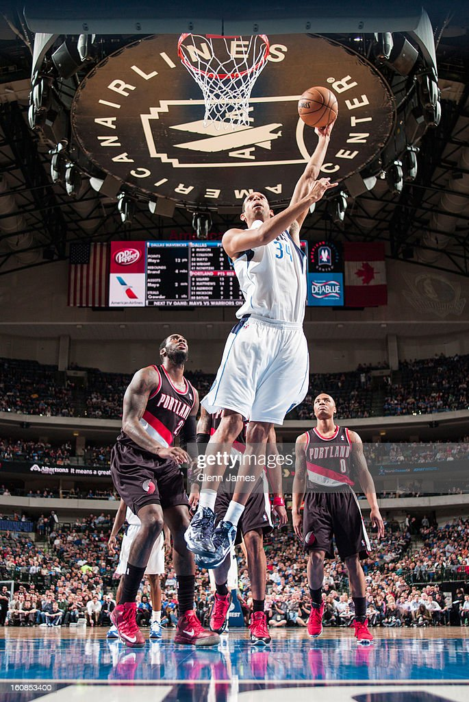 <a gi-track='captionPersonalityLinkClicked' href=/galleries/search?phrase=Brandan+Wright&family=editorial&specificpeople=3847557 ng-click='$event.stopPropagation()'>Brandan Wright</a> #34 of the Dallas Mavericks puts in the layup against <a gi-track='captionPersonalityLinkClicked' href=/galleries/search?phrase=J.J.+Hickson&family=editorial&specificpeople=4226173 ng-click='$event.stopPropagation()'>J.J. Hickson</a> #21 of the Portland Trail Blazers on February 6, 2013 at the American Airlines Center in Dallas, Texas.