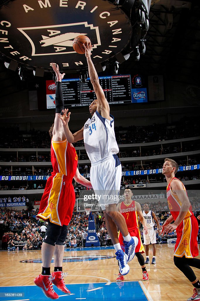 Brandan Wright #34 of the Dallas Mavericks puts up the hook shot against Omer Asik #3 of the Houston Rockets on March 6, 2013 at the American Airlines Center in Dallas, Texas.