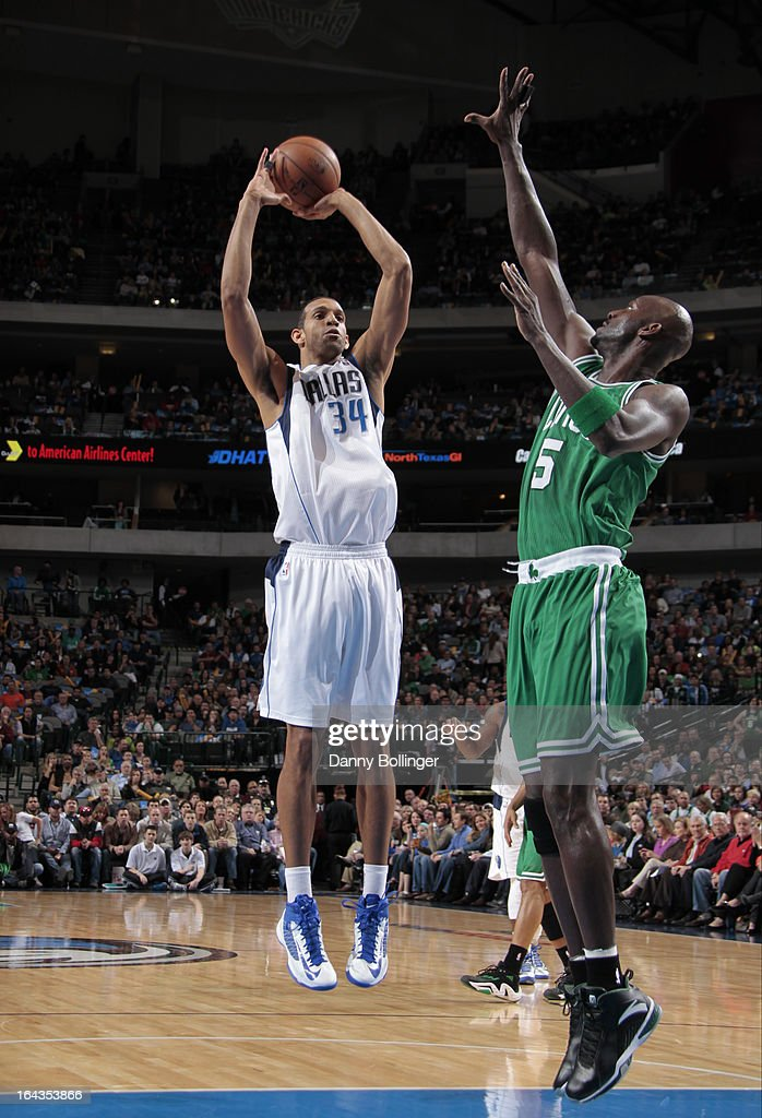 Brandan Wright #34 of the Dallas Mavericks shoots a jumper against Kevin Garnett #5 of the Boston Celtics on March 22, 2013 at the American Airlines Center in Dallas, Texas.
