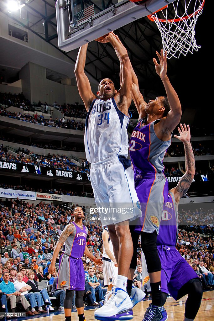 Brandan Wright #34 of the Dallas Mavericks shoots a layup against Wesley Johnson #2 of the Phoenix Suns on January 27, 2013 at the American Airlines Center in Dallas, Texas.