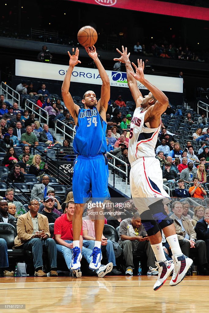 <a gi-track='captionPersonalityLinkClicked' href=/galleries/search?phrase=Brandan+Wright&family=editorial&specificpeople=3847557 ng-click='$event.stopPropagation()'>Brandan Wright</a> #34 of the Dallas Mavericks shoots against <a gi-track='captionPersonalityLinkClicked' href=/galleries/search?phrase=Al+Horford&family=editorial&specificpeople=699030 ng-click='$event.stopPropagation()'>Al Horford</a> #15 of the Atlanta Hawks on March 18, 2013 at Philips Arena in Atlanta, Georgia.