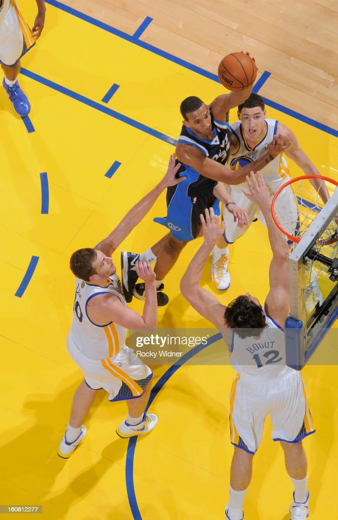 <a gi-track='captionPersonalityLinkClicked' href=/galleries/search?phrase=Brandan+Wright&family=editorial&specificpeople=3847557 ng-click='$event.stopPropagation()'>Brandan Wright</a> #34 of the Dallas Mavericks shoots against <a gi-track='captionPersonalityLinkClicked' href=/galleries/search?phrase=Andrew+Bogut&family=editorial&specificpeople=207105 ng-click='$event.stopPropagation()'>Andrew Bogut</a> #12 of the Golden State Warriors on January 31, 2013 at Oracle Arena in Oakland, California.