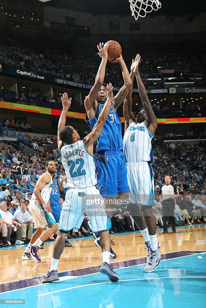 <a gi-track='captionPersonalityLinkClicked' href=/galleries/search?phrase=Brandan+Wright&family=editorial&specificpeople=3847557 ng-click='$event.stopPropagation()'>Brandan Wright</a> #34 of the Dallas Mavericks shoots against <a gi-track='captionPersonalityLinkClicked' href=/galleries/search?phrase=Roger+Mason+Jr.&family=editorial&specificpeople=220399 ng-click='$event.stopPropagation()'>Roger Mason Jr.</a> #8 of the New Orleans Hornets on April 14, 2013 at the New Orleans Arena in New Orleans, Louisiana.