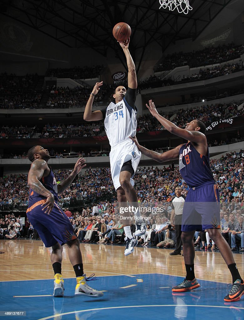 Brandan Wright #34 of the Dallas Mavericks shoots against the Phoenix Suns on April 12, 2014 at the American Airlines Center in Dallas, Texas.