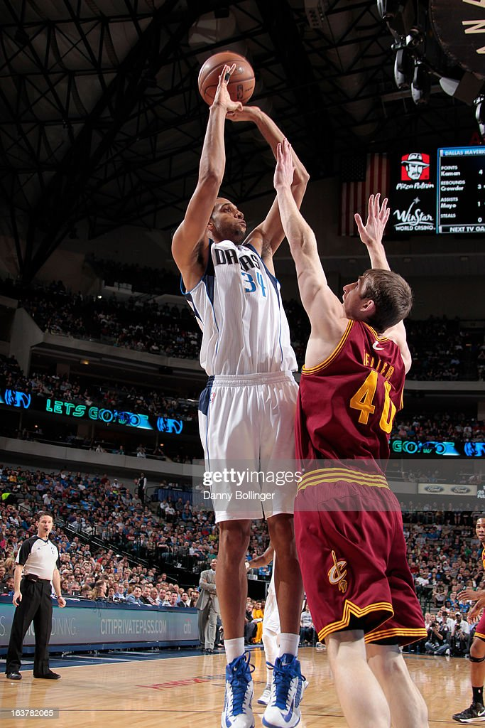 <a gi-track='captionPersonalityLinkClicked' href=/galleries/search?phrase=Brandan+Wright&family=editorial&specificpeople=3847557 ng-click='$event.stopPropagation()'>Brandan Wright</a> #34 of the Dallas Mavericks shoots against <a gi-track='captionPersonalityLinkClicked' href=/galleries/search?phrase=Tyler+Zeller&family=editorial&specificpeople=5122156 ng-click='$event.stopPropagation()'>Tyler Zeller</a> #40 of the Cleveland Cavaliers on March 15, 2013 at the American Airlines Center in Dallas, Texas.