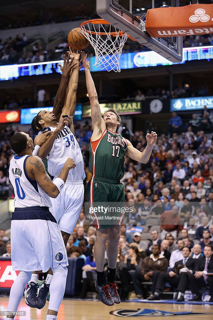 Brandan Wright #34 of the Dallas Mavericks takes a shot against Mike Dunleavy #17 of the Milwaukee Bucks at American Airlines Center on February 26, 2013 in Dallas, Texas.