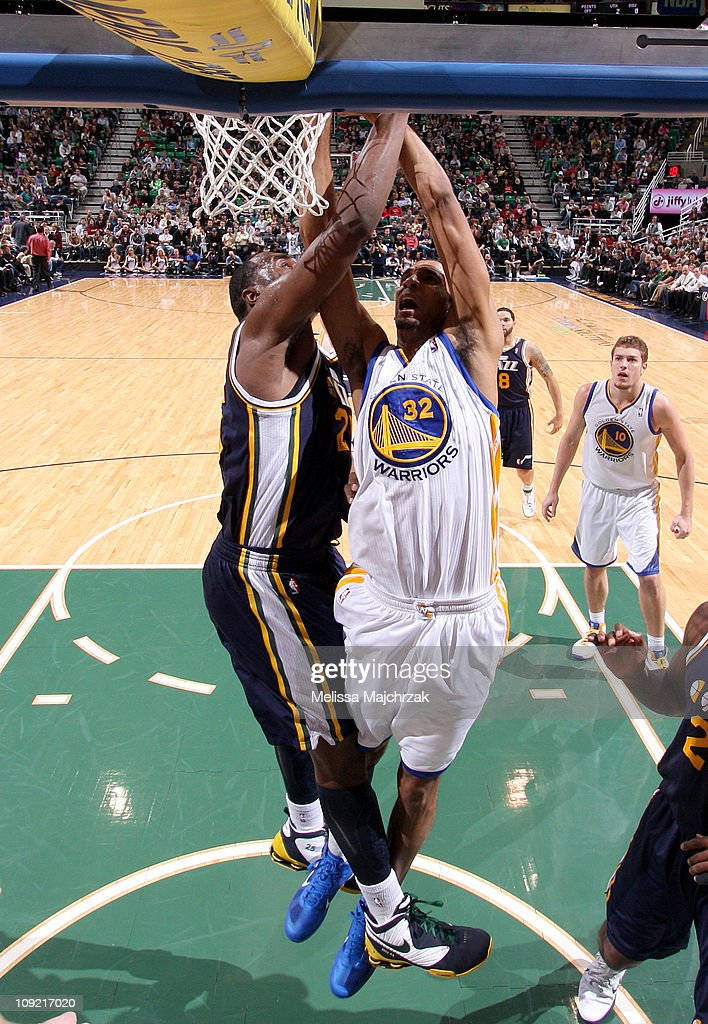 <a gi-track='captionPersonalityLinkClicked' href=/galleries/search?phrase=Brandan+Wright&family=editorial&specificpeople=3847557 ng-click='$event.stopPropagation()'>Brandan Wright</a> #32 of the Golden State Warriors is fouled on his way to the basket by <a gi-track='captionPersonalityLinkClicked' href=/galleries/search?phrase=Al+Jefferson&family=editorial&specificpeople=201604 ng-click='$event.stopPropagation()'>Al Jefferson</a> #25 of the Utah Jazz at EnergySolutions Arena on February 16, 2011 in Salt Lake City, Utah.
