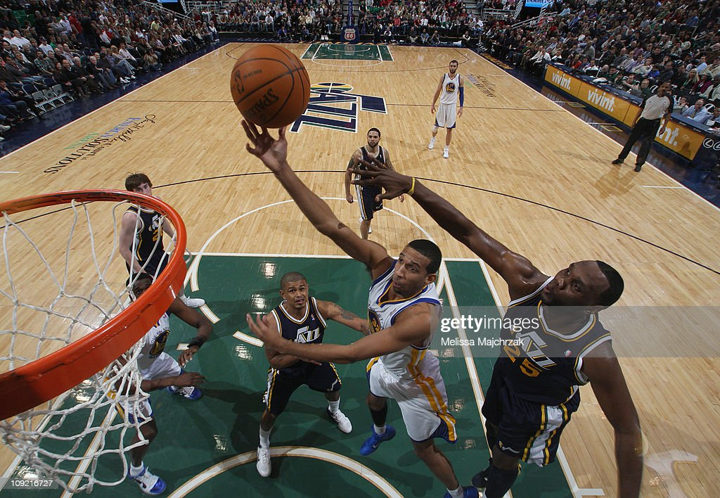 <a gi-track='captionPersonalityLinkClicked' href=/galleries/search?phrase=Brandan+Wright&family=editorial&specificpeople=3847557 ng-click='$event.stopPropagation()'>Brandan Wright</a> #32 of the Golden State Warriors lays it up against <a gi-track='captionPersonalityLinkClicked' href=/galleries/search?phrase=Al+Jefferson&family=editorial&specificpeople=201604 ng-click='$event.stopPropagation()'>Al Jefferson</a> #25 of the Utah Jazz at EnergySolutions Arena on February 16, 2011 in Salt Lake City, Utah.