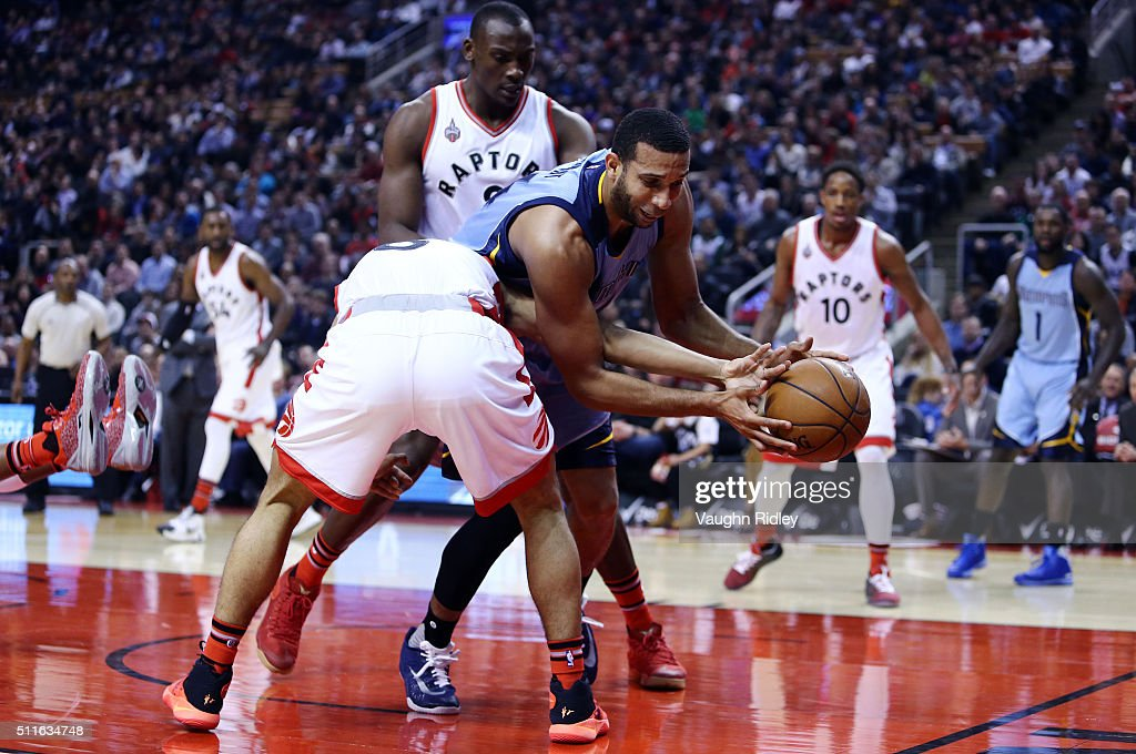Brandan Wright #34 of the Memphis Grizzlies battles for the ball with Cory Joseph #6 of the Toronto Raptors during the first half of an NBA game at the Air Canada Centre on February 21, 2016 in Toronto, Ontario, Canada.