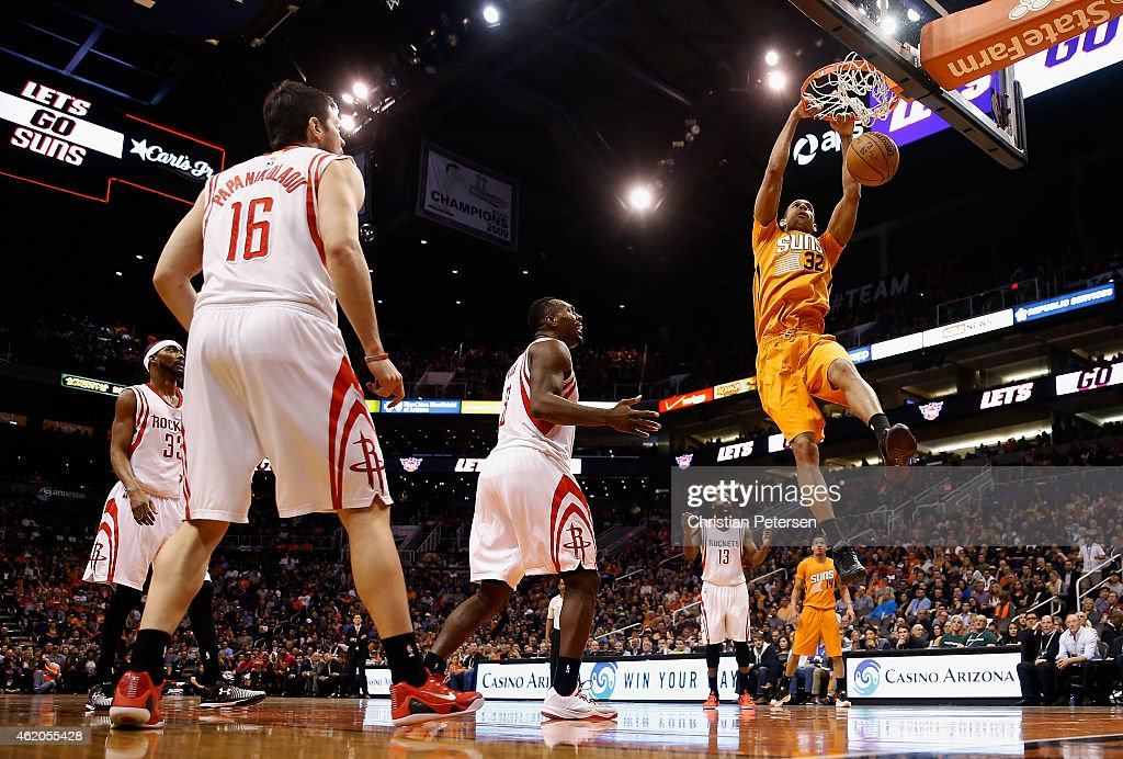 <a gi-track='captionPersonalityLinkClicked' href=/galleries/search?phrase=Brandan+Wright&family=editorial&specificpeople=3847557 ng-click='$event.stopPropagation()'>Brandan Wright</a> #32 of the Phoenix Suns slam dunks the ball past <a gi-track='captionPersonalityLinkClicked' href=/galleries/search?phrase=Joey+Dorsey&family=editorial&specificpeople=728526 ng-click='$event.stopPropagation()'>Joey Dorsey</a> #8 of the Houston Rockets during the second half of the NBA game at US Airways Center on January 23, 2015 in Phoenix, Arizona. The Rockets defeated the Suns 113-111.