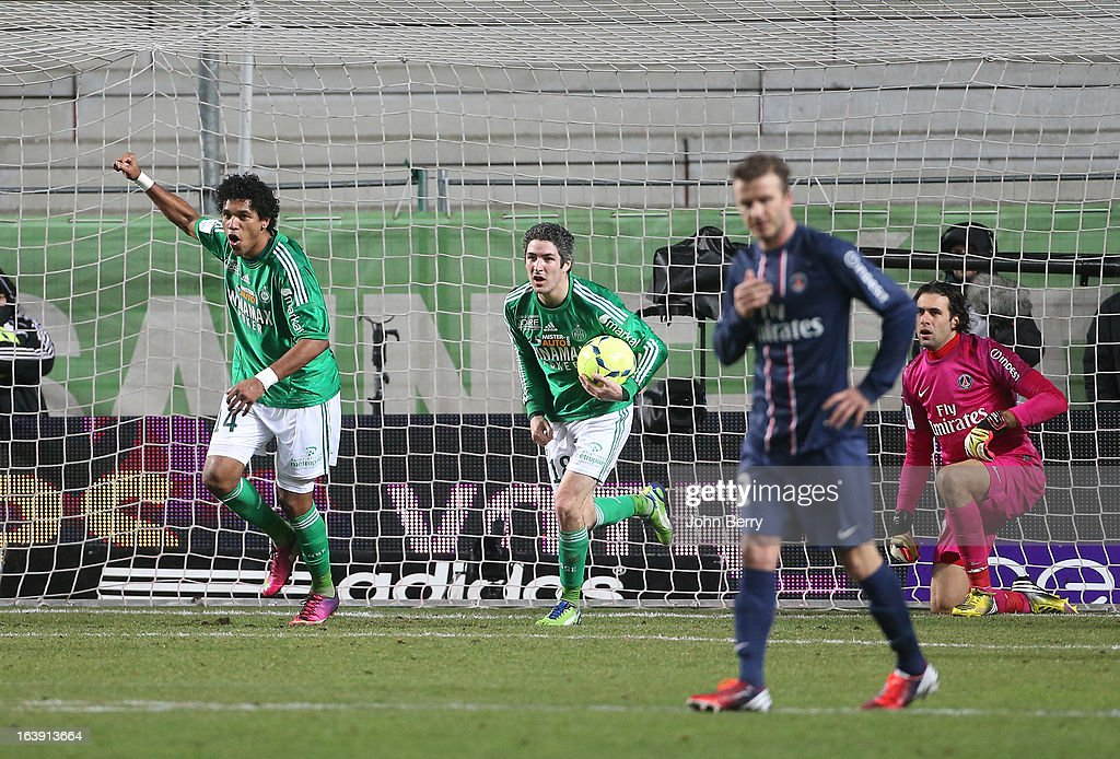 Brandao and Fabien Lemoine of Saint-Etienne celebrate a goal while David Beckham and Salvatore Sirigu of PSG look on during the Ligue 1 match between AS Saint-Etienne ASSE and Paris Saint-Germain FC at the Stade Geoffroy-Guichard on March 17, 2013 in Saint-Etienne, France.