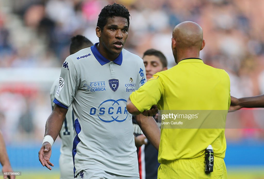 Brandao of Bastia is shown a yellow card by referee Amaury Delerue during the French Ligue 1 match between Paris Saint Germain FC and SC Bastia at Parc des Princes stadium on August 16, 2014 in Paris, France.